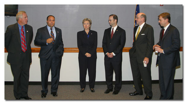 From left, Congressman Shimkus, Chairman Powell, Senator Clinton, Commissioner Adelstein, Commissioner Copps and Commissioner Martin discuss E911 developments at the reception.