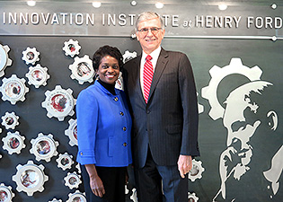 Photo of  Chairman Tom Wheeler and Commissioner Mignon Clyburn